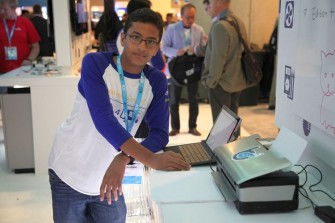Shubham Banerjee with his self-developed Braille printer at the Intel Developer Forum in September (Photo: Braigo Labs).